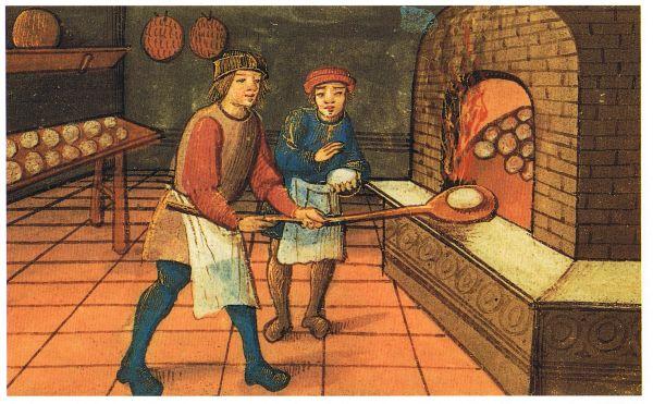 Ein Bäcker mit seinem Lehrling beim Brot backen.